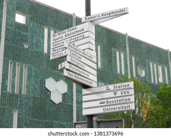 Eindhoven, The Netherlands - 23 April 2019: Signpost in the centre. Direction central station, technical university and Philips. Part of a serie.