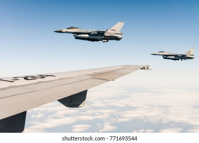 EINDHOVEN, THE NETHERLANDS - APRIL 20: Two Royal Netherlands Air Force F-16 fighter jets flying near a tanker aircraft on April 20, 2016 over the Eindhoven Air Base, Eindhoven, The Netherlands.