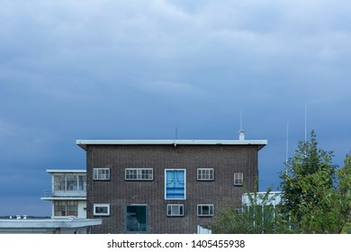 Eindhoven, Netherlands, August 23rd, 2018. Veemgebouw facade industrial building with a blue sky and a blue door, Strijp S Eindhoven City the Netherlands