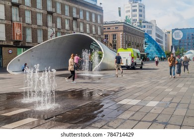 EINDHOVEN, NETHERLANDS - AUGUST 29, 2016: People walk across 18 Septemberplein square in Eindhoven.