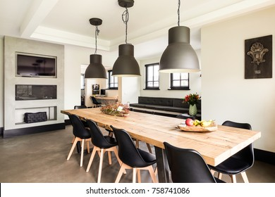 Eindhoven, The Netherlands - December 19, 2015: Large wooden dining table with chairs in a modern interior