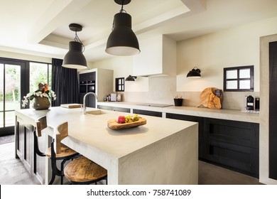 Eindhoven, The Netherlands - December 19, 2015: Beautiful large kitchen interior with island in natural tones