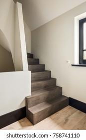 Eindhoven, The Netherlands - December 19, 2015: Modern dark concrete stairs in contemporary home interior