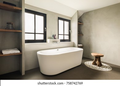 Eindhoven, The Netherlands - December 19, 2015: Interior of a contemporary bathroom with bathtub, in natural earth colors.