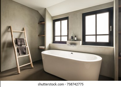 Eindhoven, The Netherlands - December 19, 2015: Modern bathroom interior with bathtub and windows in natural soft colors