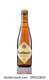 EINDHOVEN, THE NETHERLANDS - JULY 23, 2015: A bottle of Westmalle Tripel Trappist isolated on a white background.