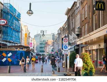 EINDHOVEN, NETHERLANDS - JULY 27, 2018 : Tourists on foot Graben Street Eindhoven, Netherlands