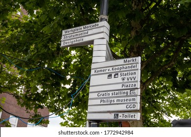 Eindhoven, The Netherlands - July 9 2020: Signpost in the centre of Eindhoven. Stratumseind, Philips, toilets, VVV, station, museum, design, bicycle shed and GGD. Brainport, part of a serie.