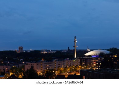 Eindhoven, The Netherlands, June 13th 2019. A view of Eindhoven city with the famous futuristic building Evoluon building during sunset with a dark blue sky and the city lights
