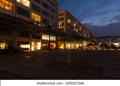 Eindhoven, The Netherlands, June 19th 2019. The famous old Philips buildings turned into city lofts with some of them having lights on at urban and creative district Strijp S in the afternoon