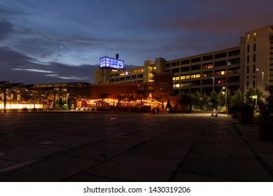 Eindhoven, The Netherlands, June 19th 2019. A view of the Ketelhuis restaurant bar with colored lights and the famous Klokgebouw at upcoming urban district Strijp S in the afternoon with a blue sky