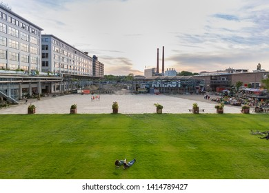Eindhoven, The Netherlands, June 1st 2019. The old Philips factories and people laying on the grass field next to the Ketelhuiplein on Strijp S during sunset