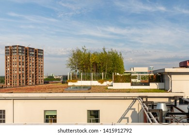 Eindhoven, The Netherlands, June 4th 2019. View of the rooftop garden of the old philips factories with trees at Strijp S to the new building with a blue sky on a sunny day