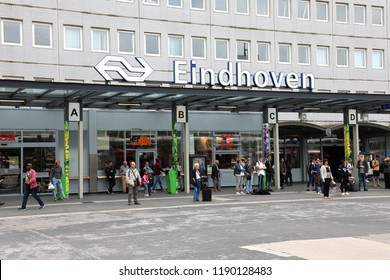 EINDHOVEN, NETHERLANDS - JUNE 5, 2018 : main train and bus station with commuters in Eindhoven, Netherlands