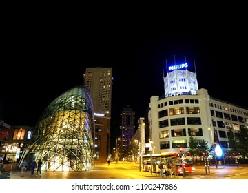 EINDHOVEN, NETHERLANDS - JUNE 5, 2018: Night view of the old Philips factory building and modern futuristic building in the city centre of Eindhoven, Netherlands