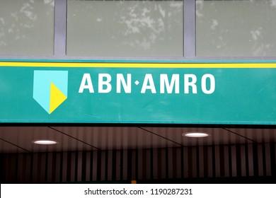 EINDHOVEN, NETHERLANDS - JUNE 5, 2018: Brand name logo ABN AMRO bank on local branch office in Eindhoven, Netherlands