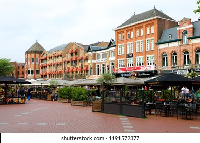 EINDHOVEN, NETHERLANDS - JUNE 5, 2018: people in restaurants at Markt square, Eindhoven, Netherlands