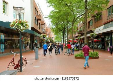 EINDHOVEN, NETHERLANDS - JUNE 5, 2018: people walking in Eindhoven main street, Netherlands