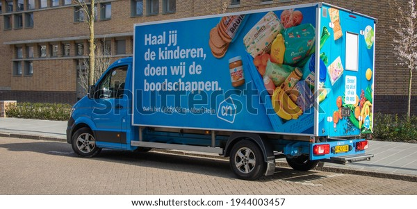 Eindhoven, The Netherlands -March 26 2021: Dutch truck AH or Albert Heijn, food delivery service. Lockdown during Corona epidemic,  part of a serie.