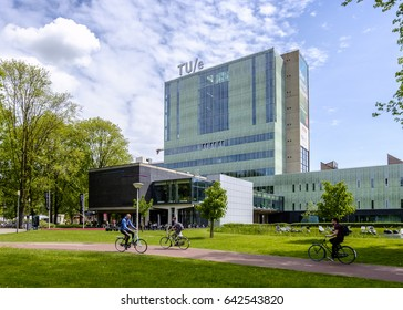 Eindhoven, Netherlands, May 2017. Buildings of the University of Technology Eindhoven (TU/e) with students passing by on bicycles