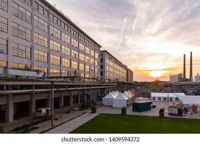 Eindhoven, The Netherlands, May 23rd 2019. A sunset view of Strijp S with the old philips factories and the Tech Festival on the Ketelhuisplein