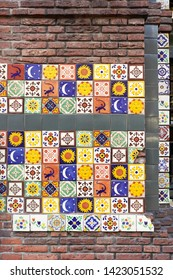 Eindhoven, Netherlands - May 27, 2019: Many decorative patterned tiles on the wall. Exterior of a cafe in Eindhoven.