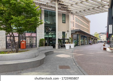 Eindhoven, The Netherlands, May 8th 2020. The centre of Eindhoven with the Nieuwe Emmasingel with shops, restaurants and a concrete bench on a sunny day during spring. Dutch public space