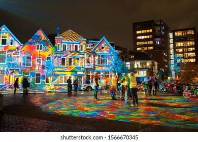 """Eindhoven, The Netherlands - November 11, 2019: Square Wilhelminaplein during light art festival """"Glow Eindhoven"""" with artwork """"Diving in the sea of colors"""" of Daniel Margraf."""