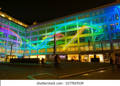 "Eindhoven, The Netherlands - November 11, 2019: festival ""Glow Eindhoven"", still of amazing light (projection mapping) show ""Colour Symphony"" (Jan Fabel/Dirk van Peppel/Erwin Steijlen)."