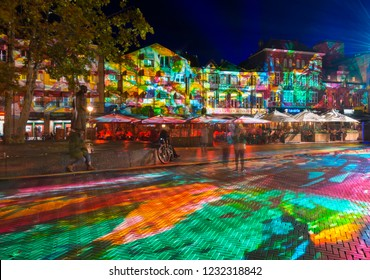 "Eindhoven, The Netherlands - November 14, 2018: Square ""Markt"" with colorful light projection, artwork ""Immersive decelerator"" (Georg Reisch of Pani) during light art festival GLOW Eindhoven."