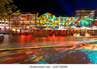 "Eindhoven, The Netherlands - November 15, 2018: Square Markt with colorful light projection, artwork ""Immersive decelerator"" (Georg Reisch of Pani) during light art festival GLOW Eindhoven."