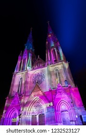 "Eindhoven, The Netherlands - November 15, 2018: Colorful Catharina Church (""Confluence"" - Ocubo Criativo) during  light art festival Glow Eindhoven."