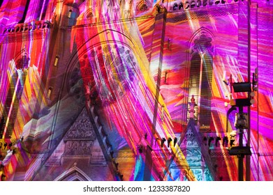 "Eindhoven, The Netherlands - November 15, 2018: Colorful Catharina Church (""Confluence"" - Ocubo Criativo) during  light art festival Glow Eindhoven. Beautiful colors."