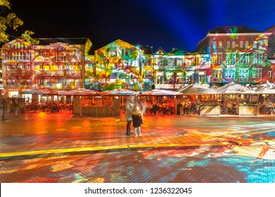 "Eindhoven, The Netherlands - November 15, 2018: Square ""Markt"" with colorful light projection, artwork ""Immersive decelerator"" (Georg Reisch of Pani) during light art festival GLOW Eindhoven."