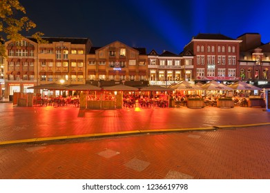 "Eindhoven, The Netherlands - November 15, 2018: Colorful square ""Markt"" in Eindhoven. In the sky blue light of the artwork Something Blue of Kari Kola of light art festival Glow Eindhoven."