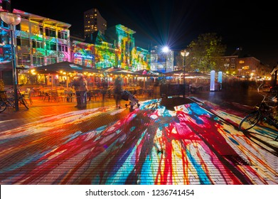 "Eindhoven, The Netherlands - November 15, 2018: Beautiful colours during art and light festival ""Glow Eindhoven"" on Square ""Markt"" , light projection artwork ""Immersive decelerator""."