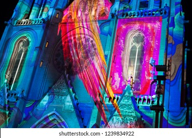 "Eindhoven, The Netherlands - November 15, 2018: Colorful Catharinakerk (Catharina Church) with artwork ""Confluence"" of Ocubo during light art festival Glow Eindhoven."