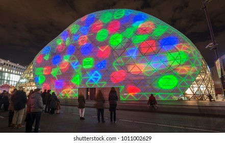 "Eindhoven, The Netherlands - November 17, 2017: spectators and artwork ""Blob the Bulb"" (light show/projection mapped) of artists Dirk van Poppel & Jan Fabel, light and art festival ""Glow Eindhoven""."