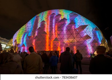 "Eindhoven, The Netherlands - November 17, 2017: Spectato in street Nieuwe Emmasingel with artwork ""Blob the Bulb""(light show) of Dirk van Poppel + Jan Faber during the light festival ""Glow Eindhoven""."