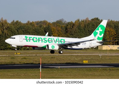 EINDHOVEN, THE NETHERLANDS - OCT 27, 2017: Transavia airlines Boeing 737 airplane landing on Eindhoven Airport.