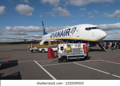 Eindhoven, Netherlands - October 7, 2018: Airplane of Ryanair getting ready for departure and boarding people from the airport of Eindhoven