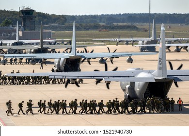 EINDHOVEN, NETHERLANDS - SEP 20, 2019: Paratroopers entering a US Air Force C-130 Hercules transport plane on Eindhoven airbase.