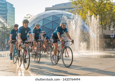 Eindhoven, The Netherlands, September 3rd 2017, A group of women race cycling through the streets of Eindhoven with a round building the blob and water in the background on a sunny morning