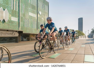 Eindhoven, The Netherlands, September 3rd 2017, A group of women race cycling through the streets of Eindhoven with the Bijenkorf in the background on a sunny morning