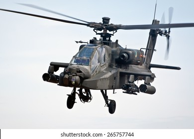 EINDHOVEN, THE NETHERLANDS--11 JUNE 2014-- A Apache helicopter from the Royal Dutch Airforce is flying through the sky.