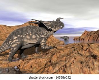 Einiosaurus dinosaur on a rock looking at an argentinosaurus dinosaur having a bath by cloudy day