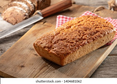 Einkorn wheat bread on cutting board.