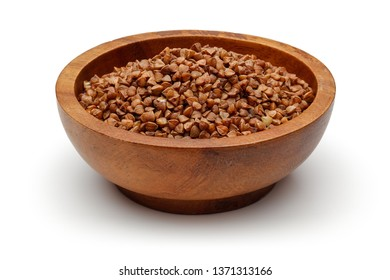 Einkorn wheat in wooden bowl isolated on white background