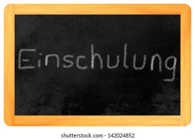 """Einschulung (German: my first day at school) written on a blackboard"