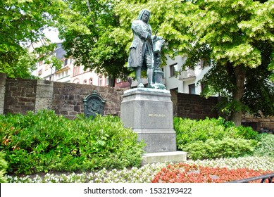 Eisenach, Germany - 2014: Johann Sebastian Bach was born in Eisenach, Germany. A statue of Bach is across the street from the Bachhaus, a museum regarding the composer and musician.